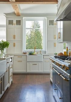 Kerry Hanson Design - White kitchen delivers a classic finish with white shaker cabinets and brass pulls. Kerry Hanson Design - White kitchen delivers a classic finish with white shaker cabinets and brass pulls. Shaker Kitchen Cabinets, White Shaker Cabinets, Tall Cabinets, French Stove, French Country Kitchens, French Farmhouse, French Cottage, Mawa Design, Kitchen Views