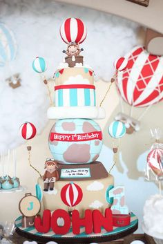 Fantastic cake at a rustic hot air balloon birthday party! See more party planning ideas at CatchMyParty.com!