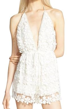 35e5d526ffaa Missguided White Romper Jumpsuit. Free shipping and guaranteed authenticity  on Missguided White Romper . Tradesy