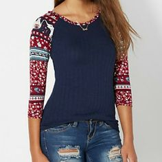 BNWT Reglan Knit Adorable super soft 3/4 length sleeves knit top. Navy blue lightweight knit center, printed red sleeves with flowers, elephants design. Size L to add extra comfort, stretchy material. Neck border, long length (if your tall)  or like to wear long over tights. Sizes available L & XL, price is for one. Tops