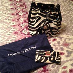 Dooney and Bourke Zebra Purse and Wallet Dooney and Bourke Zebra Purse and Wallet- has a small mark bit still in great condition. Dooney & Bourke Bags