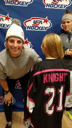 Hilary Knight takes a photo with a young player who shares the same last name.