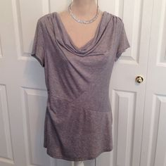 """Essentials By Milano, Low Cowl Neck Tunic Top Essentials By Milano, Light Grey Short Sleeve Low Cowl Neck Tunic Top. Gorgeous Top is Perfect for Leggings & Skinny Jeans. It's 26"""" Long, Chest Laying Flat fits up to 42"""", Waist 36"""" Flat & 39"""" Gently Stretched & Shoulder is 16"""". Soft Polyester, Rayon & Spandex Fabric Has Plenty of Stretch if needed. The Last Pic Shows a Fabric Color Run. I Bought it """"New"""" like this & Not an issue because the Low Cowl Neck Covers it. See last pics. Has Flattering…"""