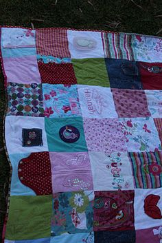 Quilt made out of outgrown baby clothes.     I should've done this before I sold or gave away all of the triplets' clothes. I have been thinking about doing it with their baby blankets though. Just need more motivation!!