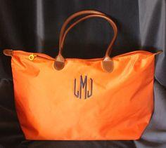 Monogrammed Tote Bag via Etsy $36 w/ monogram Comes in Navy, Orange, Pink, Red, and Black!
