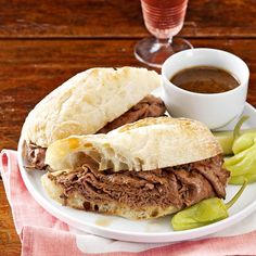 French Dip Subs with Beer Dipping Sauce Recipe -These savory subs make a family-pleasing meal that comes together in no time. The tender roast beef goes great with the hearty beer dipping sauce and a garnish of banana peppers.—Susan Simons, McKenna, Washington
