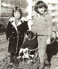 A youthful Donald and Fred Trump moving an elderly dog from her property