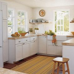 I like the warm colors and the lack of overhead cabinets makes it feel really open.