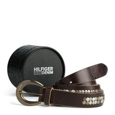 Stylish leather belt with brass and silver-toned studs along the strap. Rounded buckle with Hilfiger Denim logo embossed. Pointed tip, leather keeper.