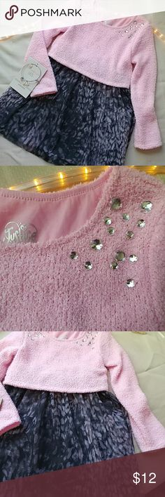Sweet girls Justice dress Cute one piece cropped pink sweater top with gray slip underneath a flowy printed skirt. Pretty little rhinestones around top Justice Dresses