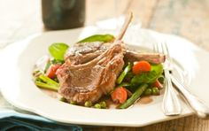Lamb Chops with Red Wine-Glazed Spring Vegetables | This elegant dish works with lamb loin OR shoulder chops! #recipe