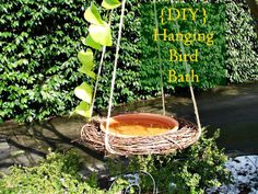 MUST do this one soon one for water and one for seed ? {DIY} Hanging bird bath