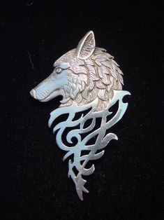 I'm really liking the designs here underneath the wolf's head. Considering using a similar pattern on something