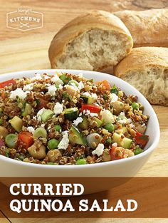 Curried Quinoa Salad: Freshly cooked Quinoa mixed with fresh chopped zucchini, red bell pepper, scallions, feta cheese, peas and Simply Dressed Balsamic Dressing with a touch of curry.