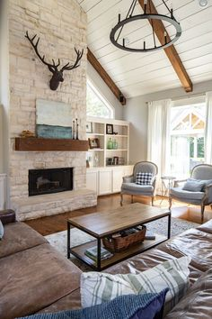 A casual, rustic Texas living room outside of Houston featuring a limestone fireplace, wood beams, leather and more! Texas Living Rooms, My Living Room, Living Room Decor, Rustic Living Rooms, Living Room Ceiling Ideas, Moore House, Living Room With Fireplace, Decoration, Limestone Fireplace