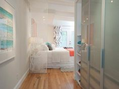A modular closet, that was once crowding a bedroom, has been moved into the newly painted hallway. The wall has been opened up to create a bright and airy entry to this master bedroom featured on HGTV's Buying and Selling.