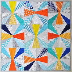 """My version of the """"Baby Jacks"""" pattern from """"Paper Pieced Modern"""" by Amy Garro (Stash Books) with Ann Kelle Remix, Kona Solids and scraps."""