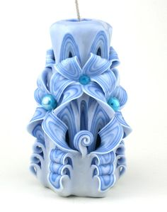 Blue and white carved candle with beads