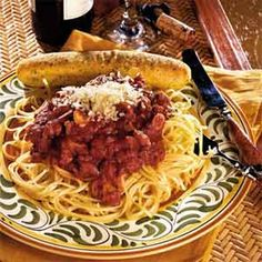 Sicilian Spaghetti Sauce Recipe Main Dishes with mild Italian sausage, lean ground beef, onions, garlic, tomato sauce, tomato paste, water, sugar, salt, dried parsley, dried basil, ground red pepper, fresh mushrooms, linguine, shredded parmesan cheese, breadstick