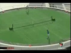 Roger Federer plays Andre Agassi on the top of the Dubai Tower tennis court on a helipad.  With literally no edge.  A must watch.