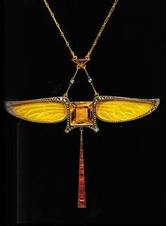 An Art Nouveau gold, diamond and citrine 'Dragonly' pendant, by Paul Fallot, circa 1900. After 1900, designers began to interpret natural motifs in the abstract, as Paul Fallot achieved in this pendant necklace, which takes the form of a dragonfly. Source: Artistic Luxury - Fabergé Tiffany Lalique