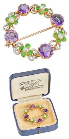 An amethyst, enamel, and pearl suffragette brooch - a rare, genuine example of suffragette jewelry. From The Three Graces.