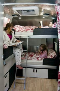 I love how they inserted the end of the third bunk between the top and bottom bunks in this Airstream. Clever use of space.
