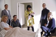 NCIS Abby holding Victoria Elizabeth Palmer. I love how they all look to Gibbs in this scene as if to say 'come on dad! get your butt in here for family time!'