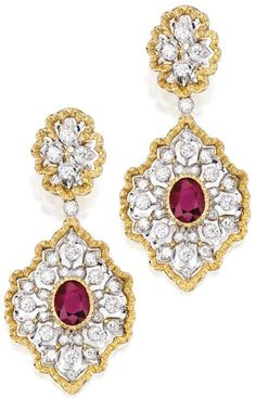 18 Karat Two-Color Gold, Ruby and Diamond Pendant-Earrings, Buccellati, Italy.   The pendants centered by two oval rubies weighing approximately 3.50 carats, accented by numerous round diamonds weighing approximately 2.20 carats, pendants detachable, signed M. Buccellati, Italy, with Italian registry marks. Sotheby's.
