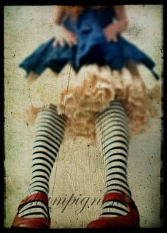 I've always love red shoes with black and white striped tights.  The blue dress over the petticoat is just a bonus.