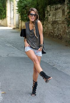 Denim shorts, studded shirt, gladiator sandals. Plus 37 other denim shorts outfits!