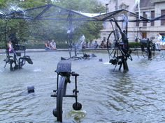 Winter has filled her garden with kinetic sculptures–art that moves.  One of my inspirations for her art was  Tinguely Fountain in Basel, Switzerland. The artist, Jean Tinguely, created this series of sculptures in 1971. The first one is Winter's inspiration for her Pawing Man sculpture.