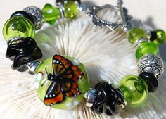 love this butterfly bead, by Kerri Fuhr, made up into a bracelet by Denise at livilubaby