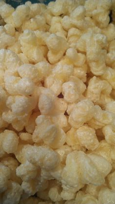 One bag of puff corn, 4-5 squares white almond bark.  Melt squares in microwave safe bowl for 1-1 1/2 mins.  Melt more if need be and pour over puff corn and stir until coated.  For something extra melt chocolate and drizzle over.  This stuff is addicting!