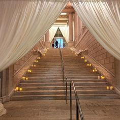 Candles and draping welcome guests to a spectacular event. #mccallsfloral #mccallssf #mccallscatering #asianartmuseum