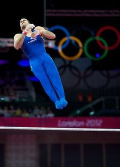 Danell Leyva of Team USA competes on the high bar during the London Olympics men's gymnastics event finals.