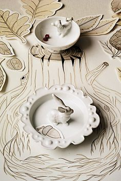Ring dish-could do this with flea market found dish, toy animal, glue, and spray paint
