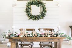 Bride and Groom Sweetheart Table with Wooden Farm Table with Mr. and Mrs. Sign and Table Garland | Greenery Plant Wedding Wreath Decor with Wedding Sign | Rustic, Country Wedding Inspiration | Tampa Bay Wedding Reception