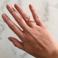 LF Criss Cross Ring LF Criss Cross Crystal Ring - super cute, I just never wear it. Size 7. Gold plated, 925 silver (see imprint on 2nd photo). NO TRADES. Poshmark transactions only. Will consider reasonable offers :)  LF Jewelry Rings
