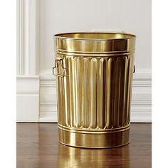Glossy gold galvanized iron wastebin treats your trash like treasure. Classic, sturdy shape adds a clever wink to office, kitchen, bath.