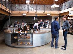 Polished concrete floor, sandblasted wood, custom steel railings | First Look at Sightglass Coffee Roasters - NYTimes.com