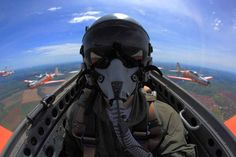 Inside a formation flying Tucano training aircraft on the Air Force Academy in Pirassununga. By Johnson Barros. This photograph was chosen by the editors as one of the best in the category Selfies on the 23rd Annual Photo Contest of the magazine Aviation Week.