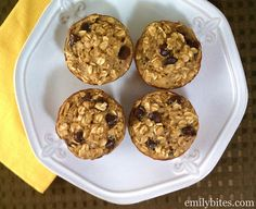 Banana Chocolate Chip Baked Oatmeal Muffins   ----- 3 cups old-fashioned oats 1/2 cup packed brown sugar 2 teaspoons baking powder 1/2 teaspoon salt 2 egg whites 1 egg 1 ¼ cups skim milk ¾ c mashed bananas 1 teaspoon vanilla extract ¾ c semi-sweet chocolate chips