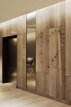 Dont necessarily love this but it could be an option to do a wide plank vertical wood cladding at the elevators.