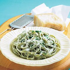 Fettuccine Alfredo Light   MyRecipes.com 1 (12 oz.) box spinach  fettuccine  1 3/4 cups 2% milk $  1 tablespoon cornstarch  1 tablespoon all-purpose flour $  1/2 tablespoon unsalted butter  1 small onion, finely chopped $  1/4 teaspoon kosher salt  1/2 teaspoon pepper  1/2 cup finely grated Parmesan cheese, plus additional for serving  3 tablespoons finely chopped fresh parsley