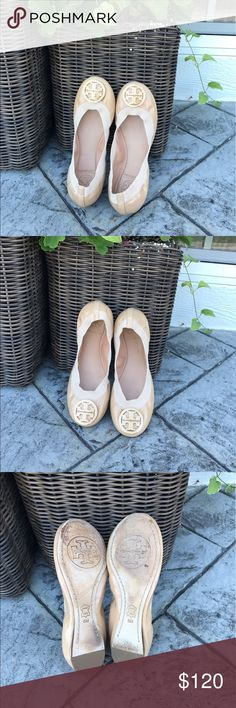 Tory Burch 'Caroline' Ballet Flats Tory Burch 'Caroline' Ballet Flats in tan patent leather with elastic. Size 5. These have been used and loved but still in very good condition. All leather is in great shape. Just wear on bottom of shoe, shown in photos and also a little stain on elastic band on the right shoe near back. Not noticeable unless you look really hard! These retail for 225$ Tory Burch Shoes Flats & Loafers