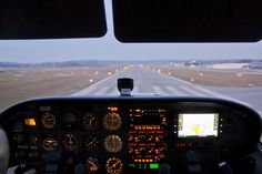 Final approach runway 07 at dusk with d-emut cessna 172 skyhawk at augsburg, germany airport after a long day full with flying.