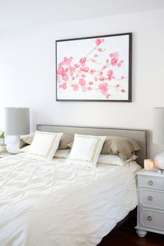 low headboard with flower print above bed