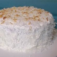 This is a coconut cake that you won't have to slave over! A white cake is filled with a cream of coconut and condensed milk mixture, topped with whipped topping and finished with flaked coconut.