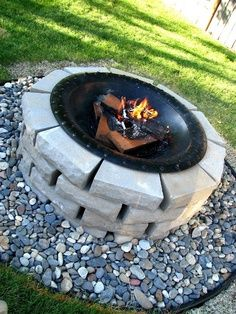 Surround freestanding metal firepit with bricks to look built in